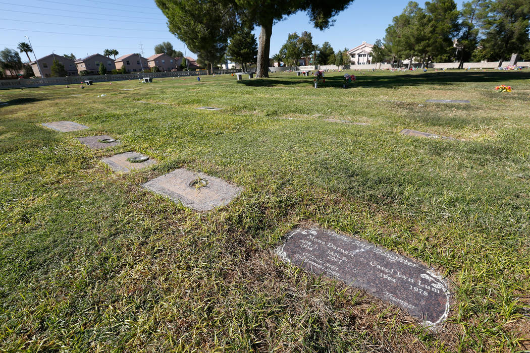 The headstone of Carol Lyn Lum, a 14-year-old girl who was killed in 1978, and her mother, Mona ...