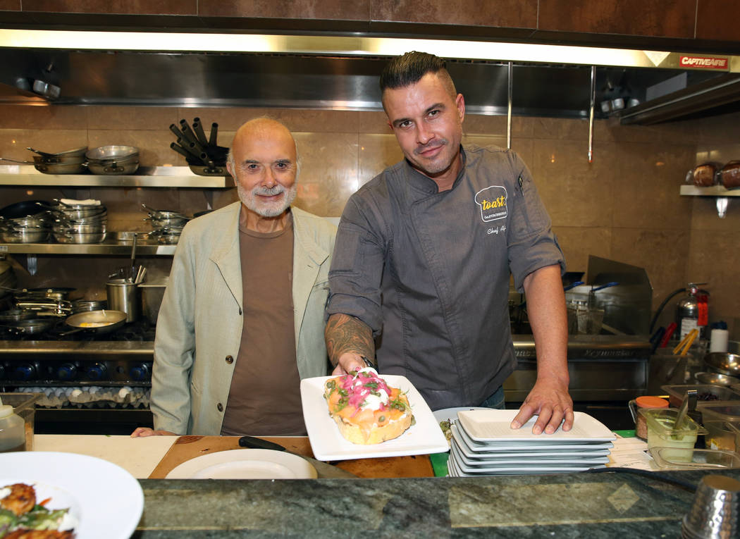 Sami Ladeki, left, owner of Toasted Gastrobrunch, and Executive Chef, Alfie Szeprethy, pose for ...