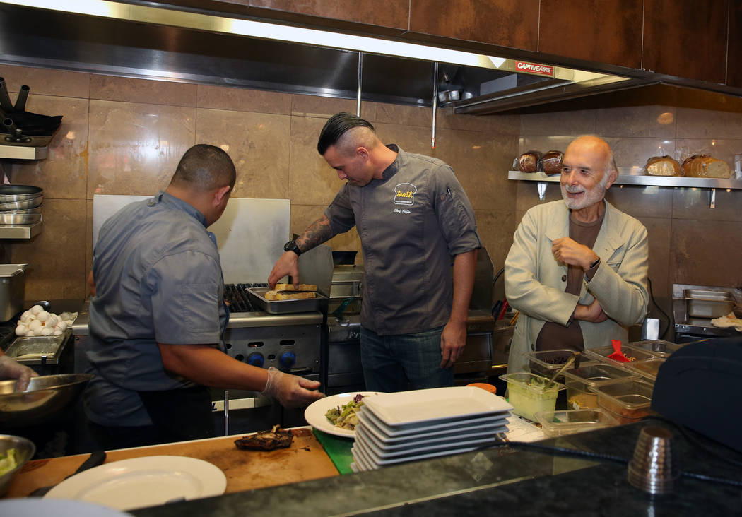 Sami Ladeki, right, owner of Toasted Gastrobrunch, checks out his kitchen at 9516 W. Flamingo R ...