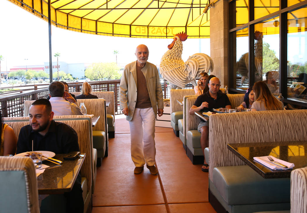 Sami Ladeki, owner of Toasted Gastrobrunch, checks out his customers at 9516 W. Flamingo Road o ...