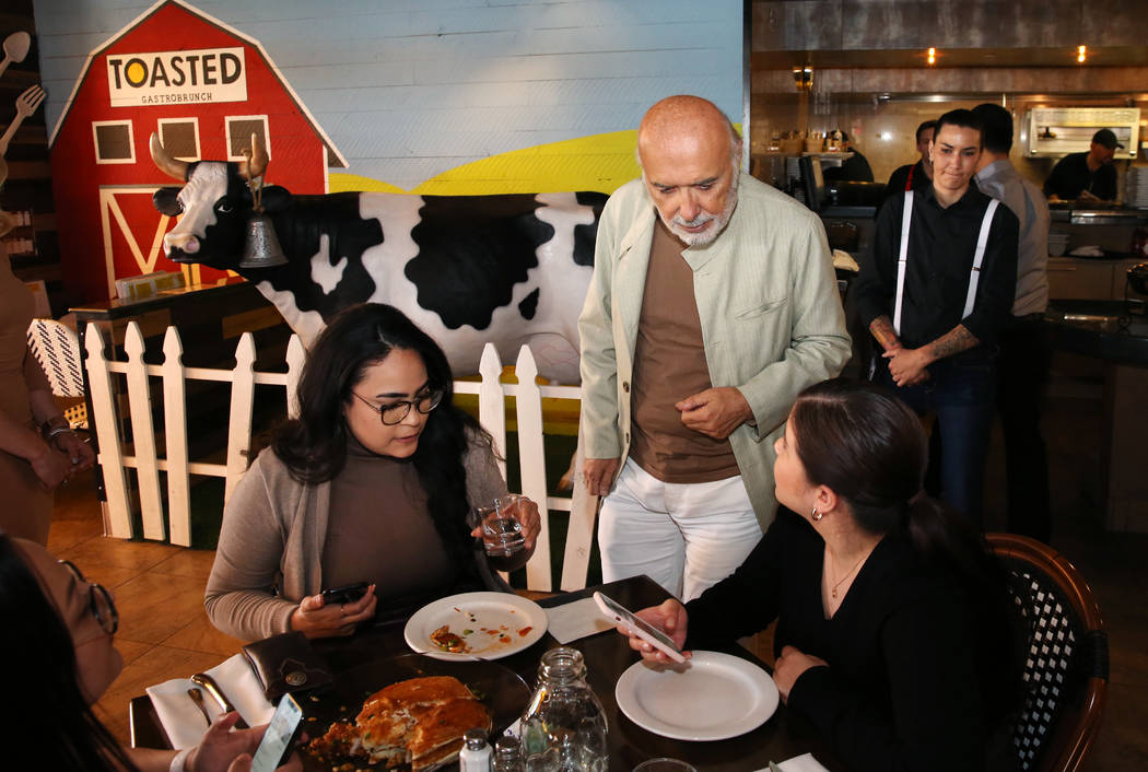 Sami Ladeki, owner of Toasted Gastrobrunch, chats with his customers at 9516 W. Flamingo Road o ...