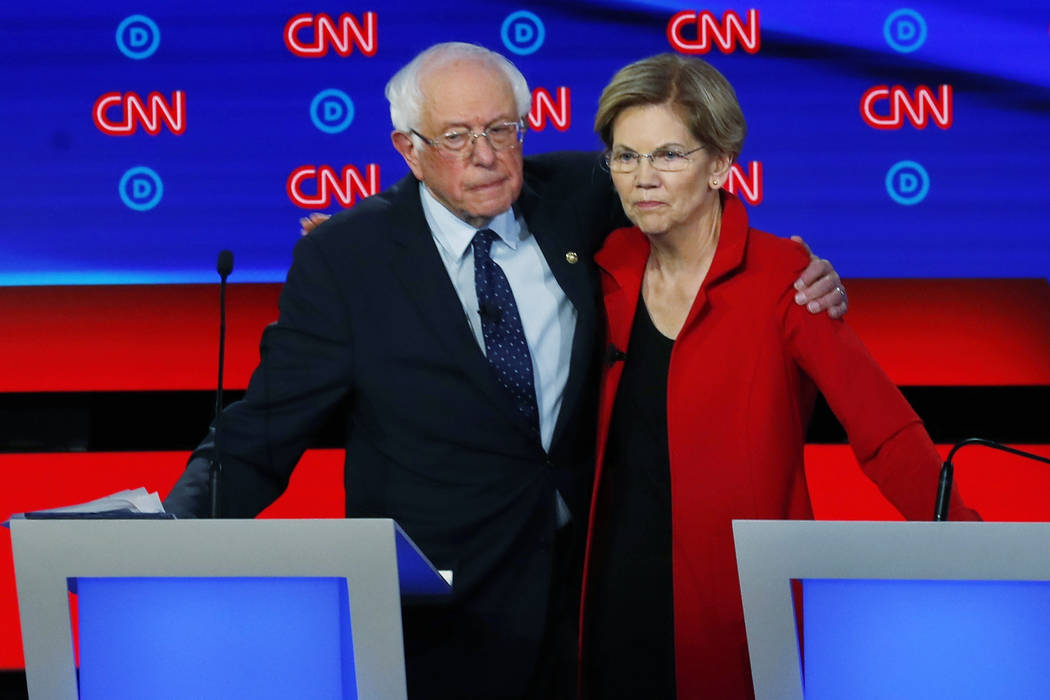 In a July 30, 2019, file photo, Sen. Bernie Sanders, I-Vt., and Sen. Elizabeth Warren, D-Mass., ...