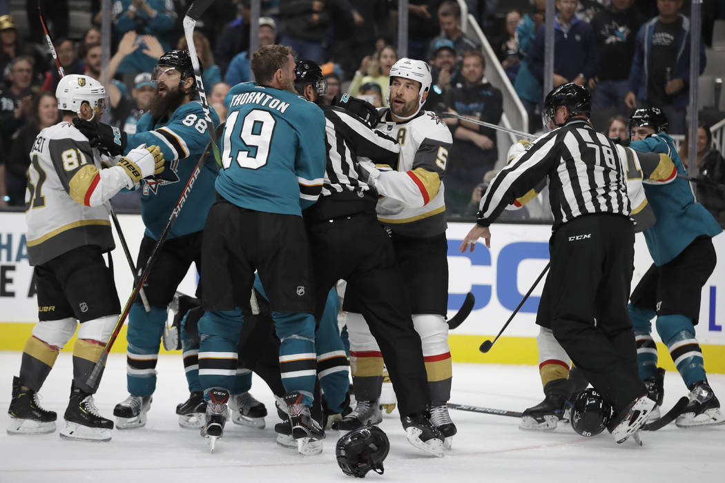 Officials try to stop a multi-player fight between the Vegas Golden Knights and the San Jose Sh ...