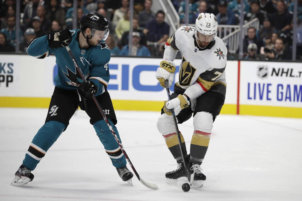 San Jose Sharks' Lean Bergmann, left, moves the puck as Vegas Golden Knights' Brandon Pirri (73 ...