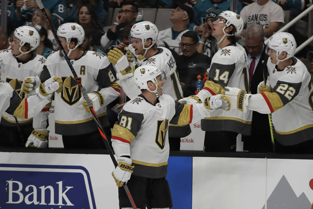Vegas Golden Knights' Jonathan Marchessault (81) is congratulated after scoring a goal against ...