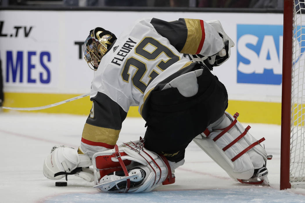 Vegas Golden Knights goalie Marc-Andre Fleury stops a shot from the San Jose Sharks during the ...