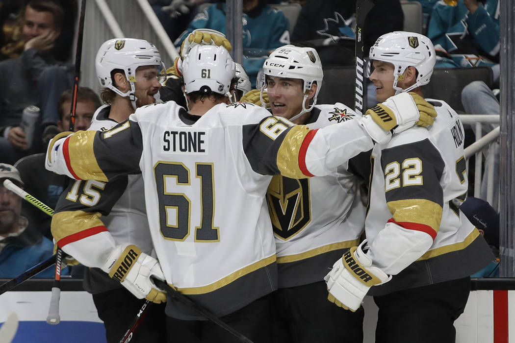 Vegas Golden Knights' Tomas Nosek, second from right, celebrates with Mark Stone (61) and Nick ...