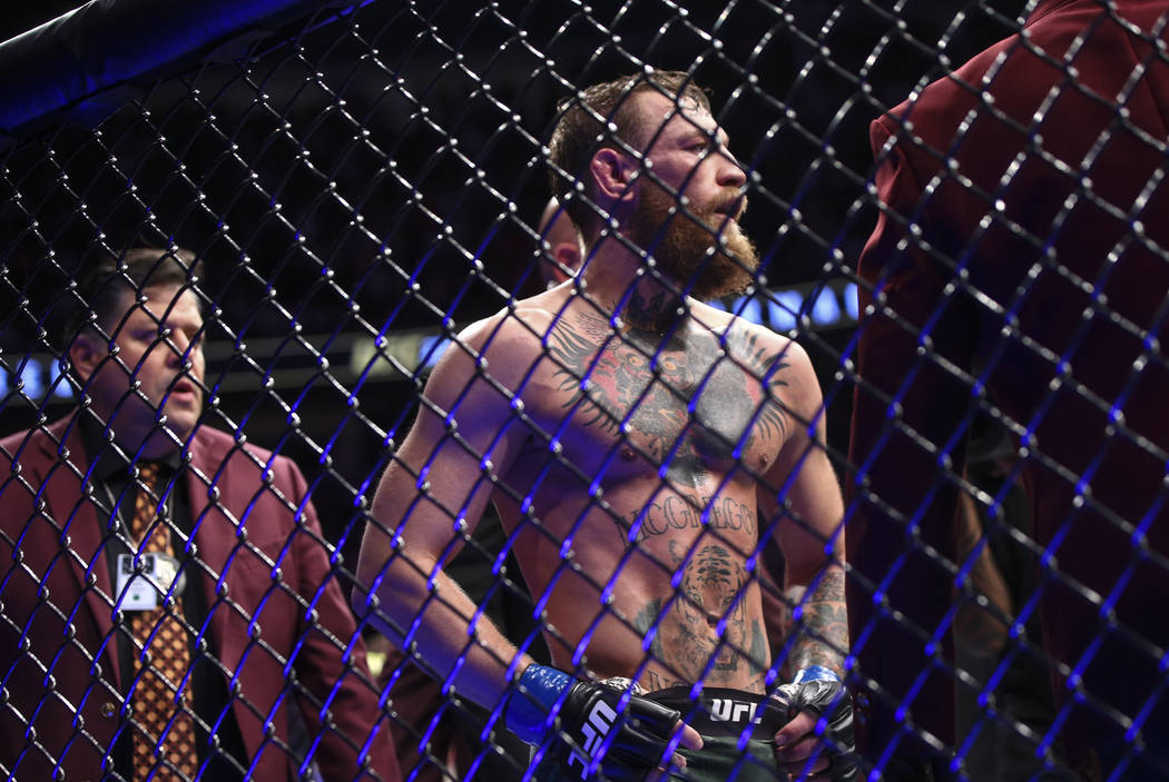 Conor McGregor reacts after his loss to Khabib Nurmagomedov in their lightweight title bout at ...