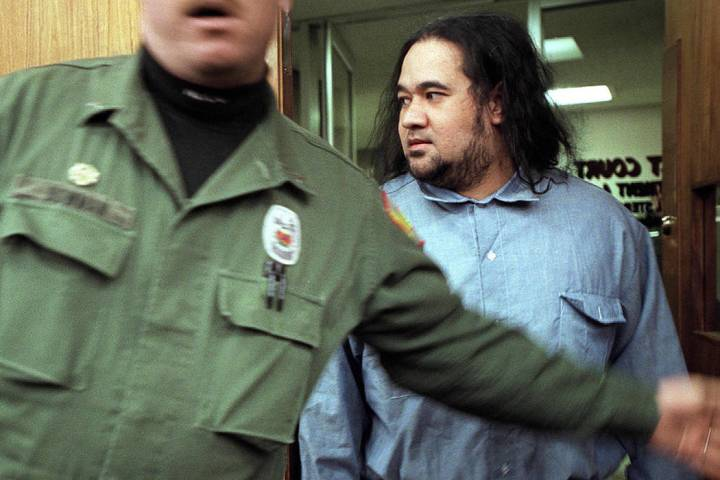 Convicted killer Siaosi Vanisi, escorted by a Nevada State Prison guard, enters court Friday, J ...