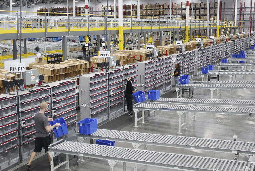 Warehouse associate assistants sort product at the Sephora Distribution Center, a 714,000-squar ...