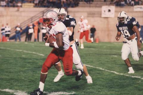UNLV wide receiver Randy Gatewood in action in a 1994 game at Utah State. Photo courtesy of UNL ...