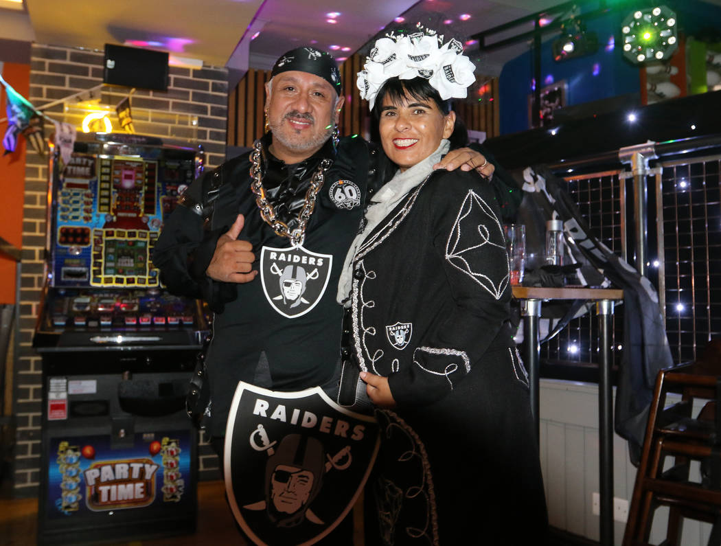 Jesse and Laura Maldonado, right, of Monterey, Calif., attend a Raiders' fan event at the Sport ...