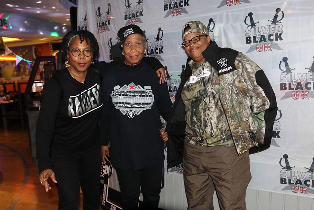 Maryland-based fans Lisa Klempko, left, and Barbara Johnson, center, and Las Vegas-based fan Br ...
