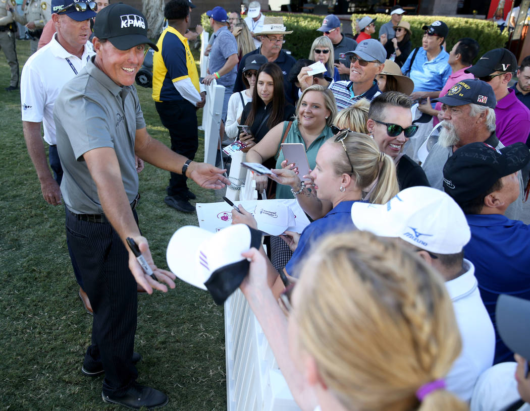 Phil Mickelson signs autographs after finishing up on the 18th hole during second round of Shri ...
