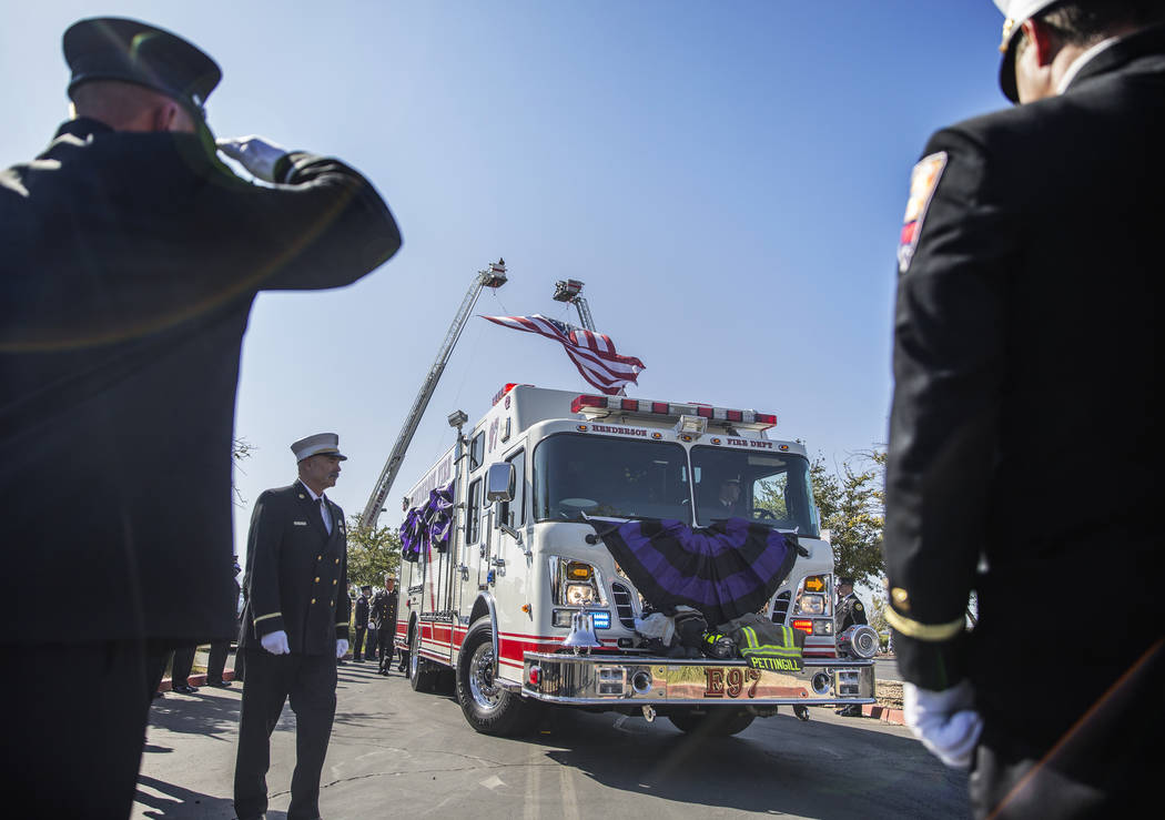 Henderson Fire and Police Department personnel march in a procession honoring Henderson Fire De ...