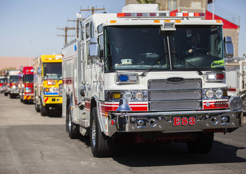 A motorcade of Henderson Fire and Police Department personnel escort the cremated remains of H ...