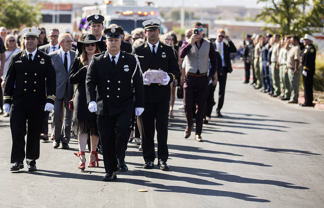 The procession for Henderson Fire Department firefighter/paramedic Robbie James Pettingill appr ...