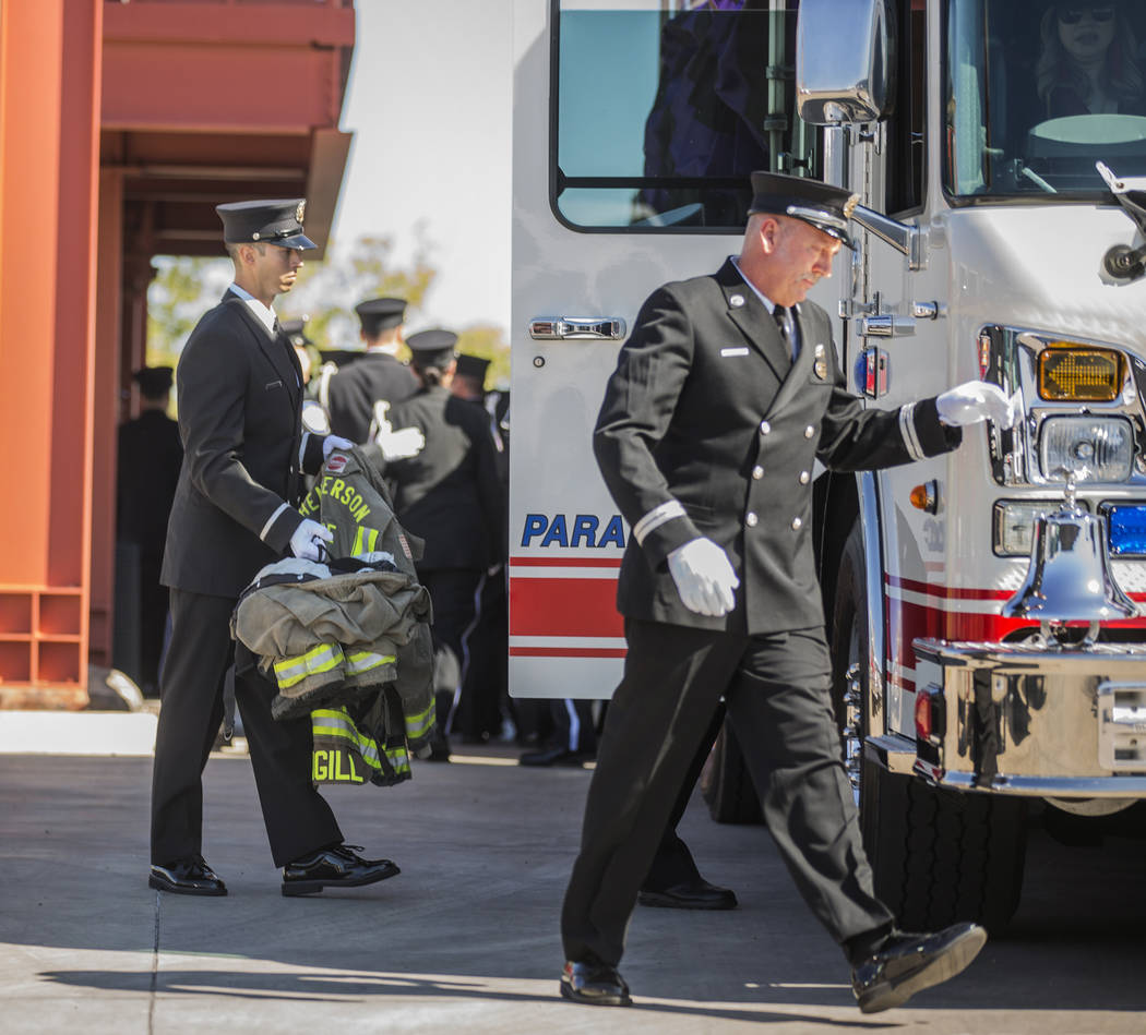 The gear of deceased Henderson Fire Department firefighter/paramedic Robbie James Pettingill is ...