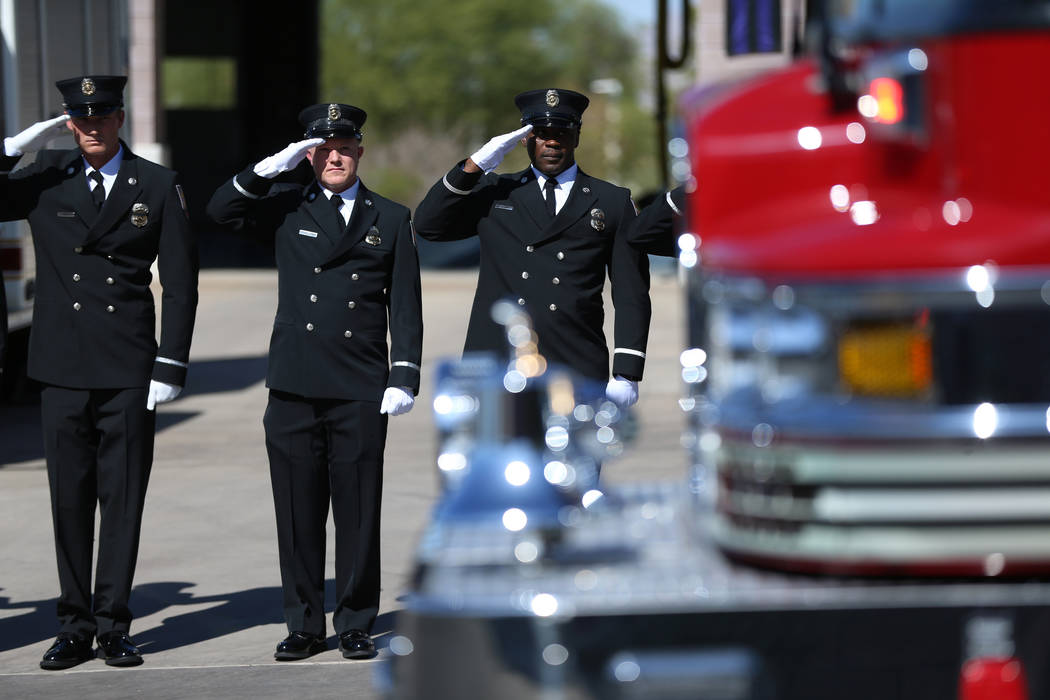 Firefighters salute during the funeral procession for firefighter Robbie James Pettingill outsi ...