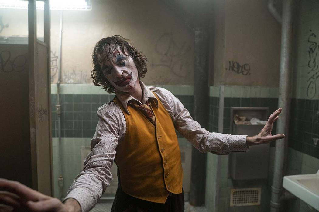 "This image released by Warner Bros. Pictures shows Joaquin Phoenix in a scene from ""Joker, ..."