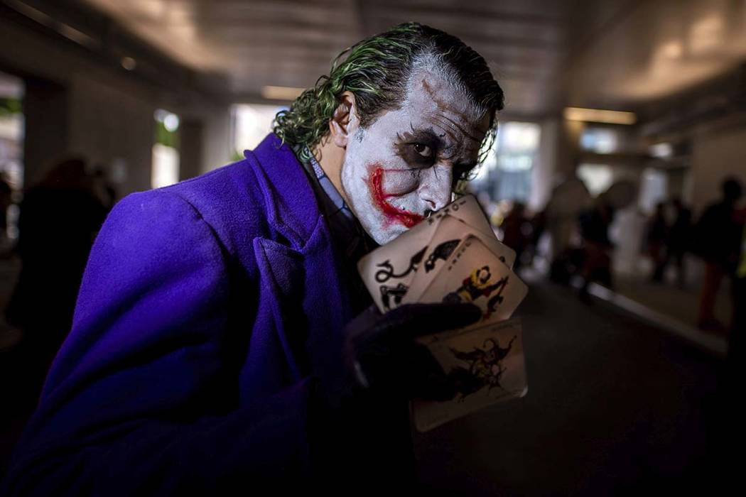 An attendee dressed as the Joker poses during New York Comic Con at the Jacob K. Javits Convent ...