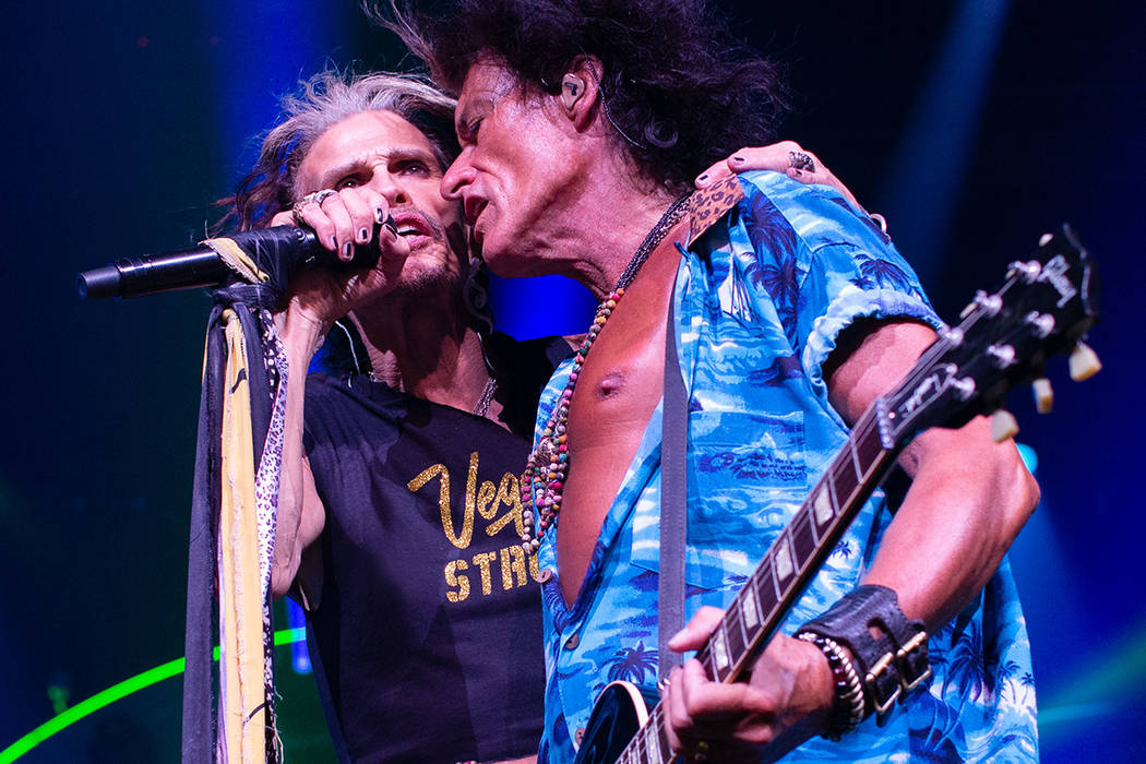 Aerosmith front man Steven Tyler sports his Vegas Strong T-shirt while performing with Joe Perr ...
