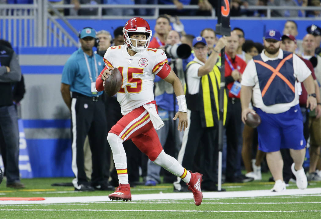 Kansas City Chiefs quarterback Patrick Mahomes (15) carries the ball against the Detroit Lions ...
