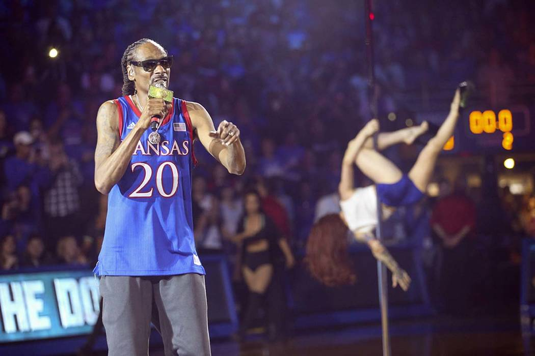 In this Friday, Oct. 4, 2019 photo, rapper Snoop Dogg performs during Late Night in the Phog, K ...