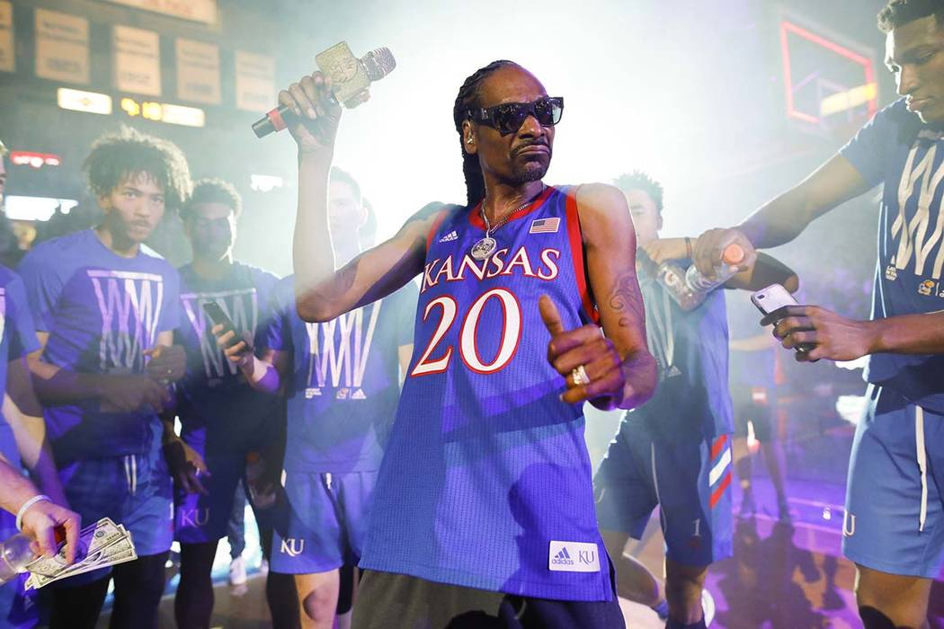 In this Friday, Oct. 4, 2019 photo, rapper Snoop Dogg performs for the Allen Fieldhouse crowd d ...