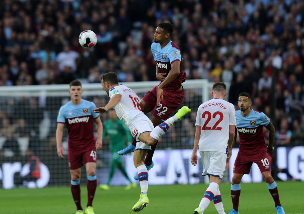 West Ham United forward Sebastien Haller (22) heads the soccer ball as he collides with Crystal ...