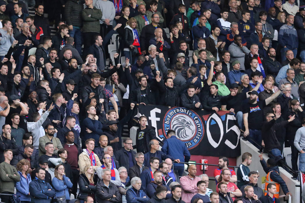 Soccer fans cheer during the first half of an English Premier League soccer match between the W ...