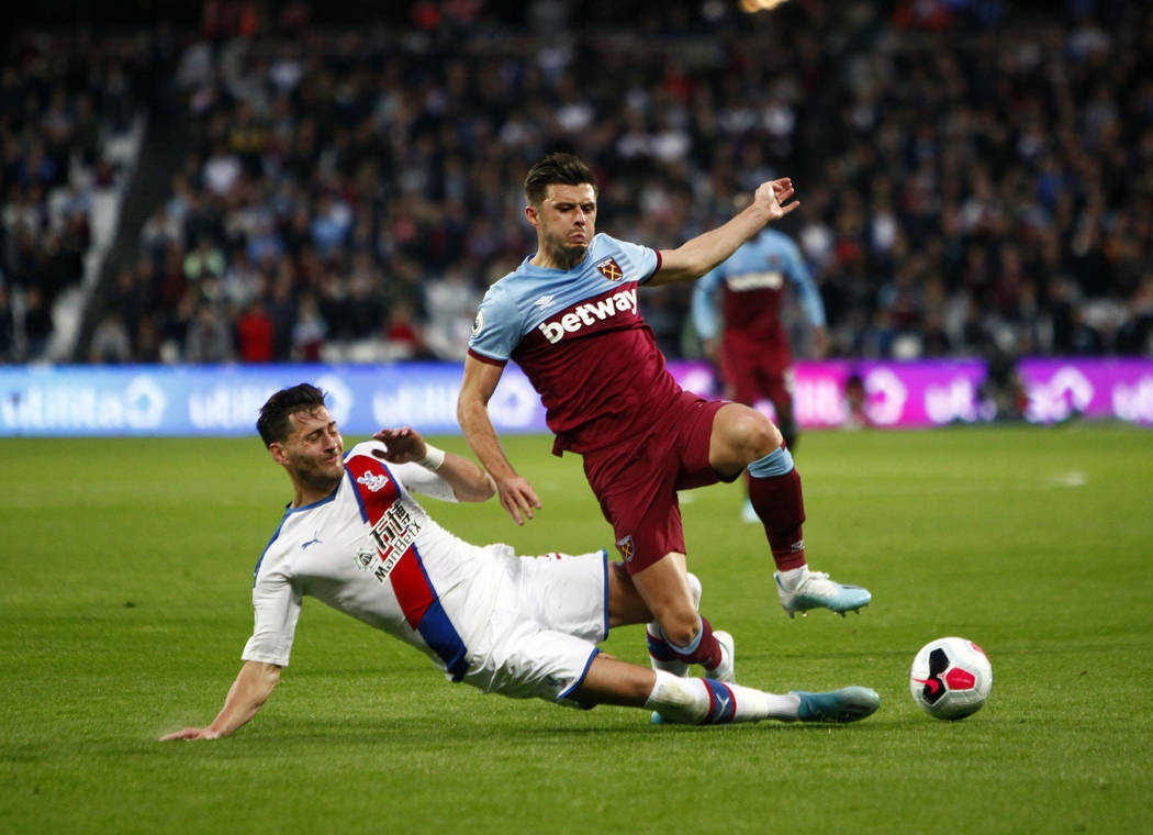 West Ham United defender Aaron Cresswell (3) attempts to kick the ball away from Crystal Palace ...