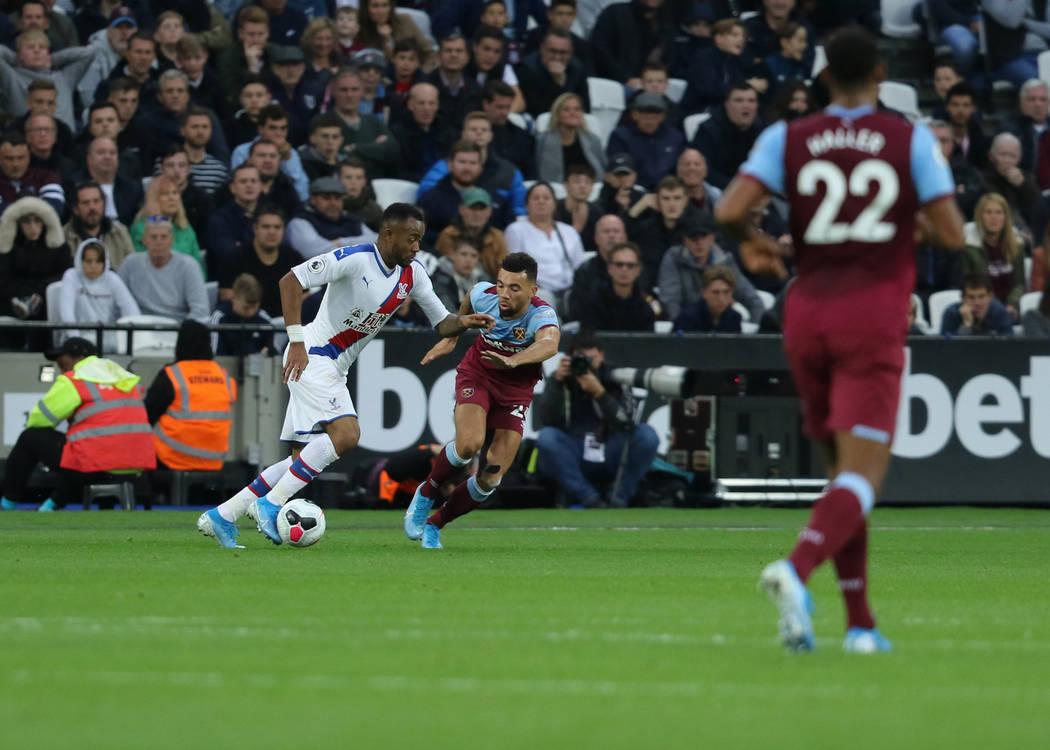 Crystal Palace forward Jordan Ayew (9) moves past West Ham United defender Ryan Fredericks (24) ...