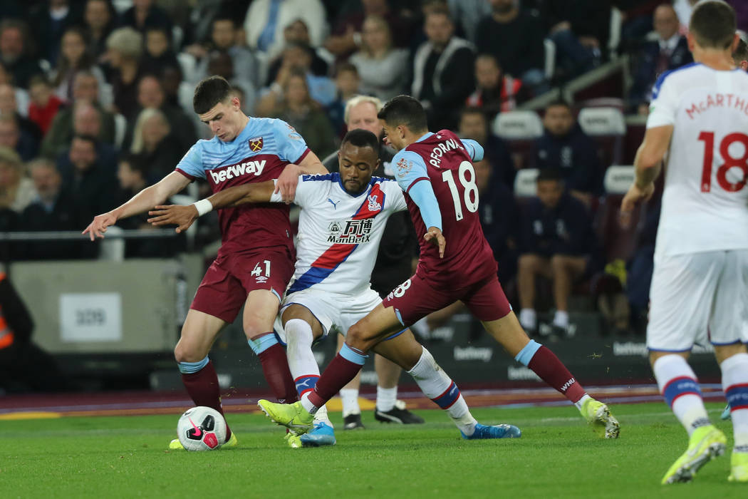 Crystal Palace forward Jordan Ayew (9) tries to recover the ball as West Ham United midfielder ...