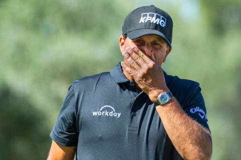 Phil Mickelson reacts to a putt on hole 1 during the third round of Shriners Hospitals for Chil ...