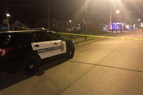 In this image from 41 KSHB Kansas City Action News police work the scene of a shooting outside ...