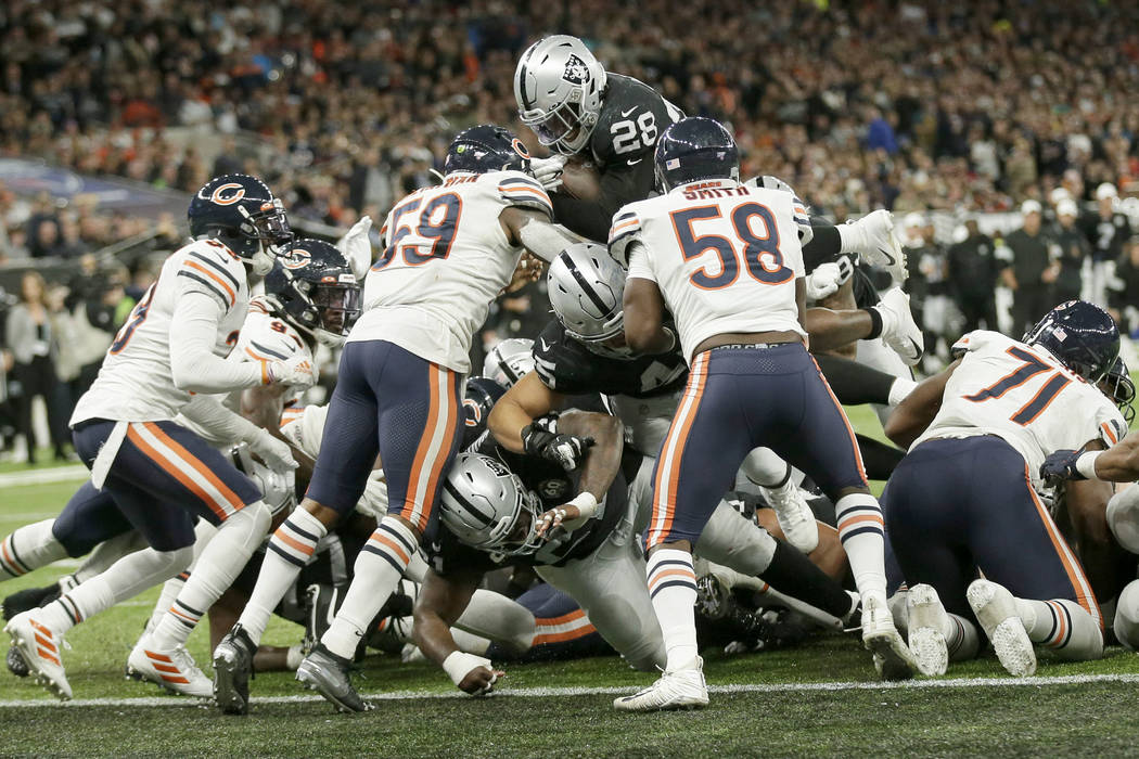 Oakland Raiders running back Josh Jacobs (28) goes in for a touchdown during the second half of ...