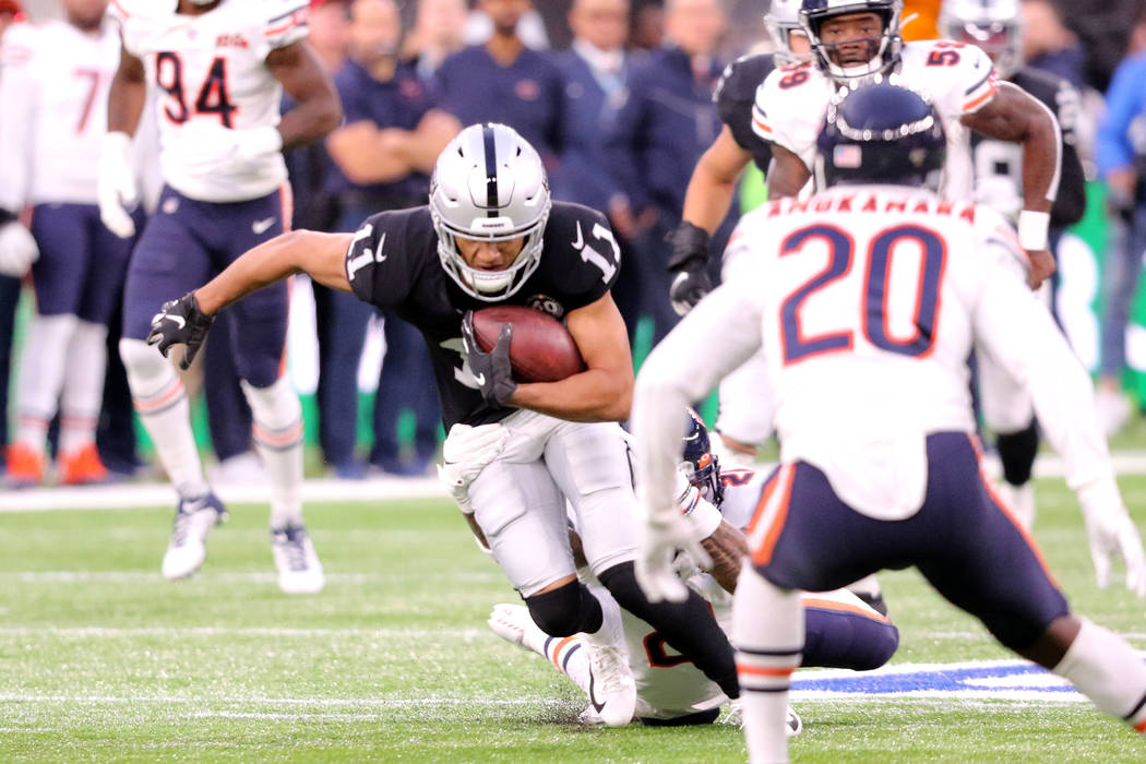 Oakland Raiders wide receiver Trevor Davis (11) tries to break a tackle from Chicago Bears stro ...
