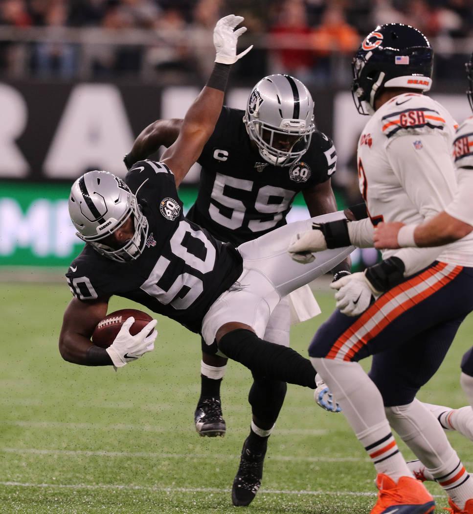Oakland Raiders linebacker Nicholas Morrow (50) intercepts Chicago Bears quarterback Chase Dani ...