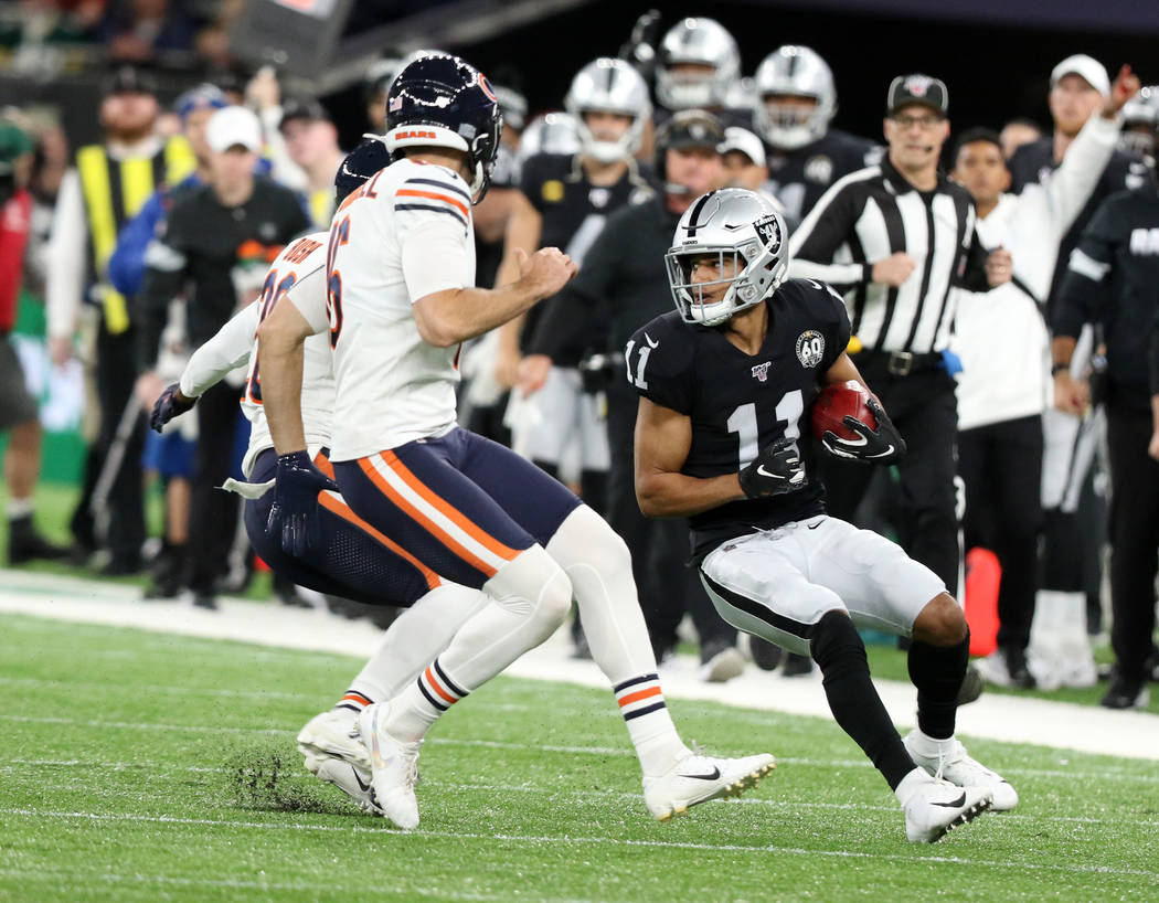 Oakland Raiders wide receiver Trevor Davis (11) looks for room to run on a kickoff return durin ...