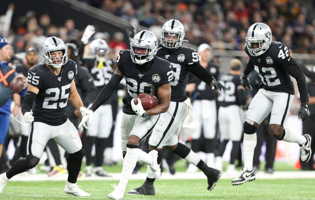Oakland Raiders cornerback Daryl Worley (20) intercepts Chicago Bears quarterback Chase Daniel ...