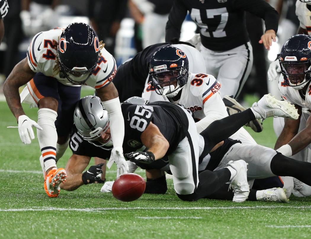 Oakland Raiders tight end Derek Carrier (85) tries to evade Chicago Bears free safety Eddie Jac ...