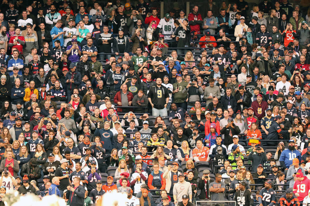 Fans attend an NFL game between the Oakland Raiders and the Chicago Bears at Tottenham Hotspur ...