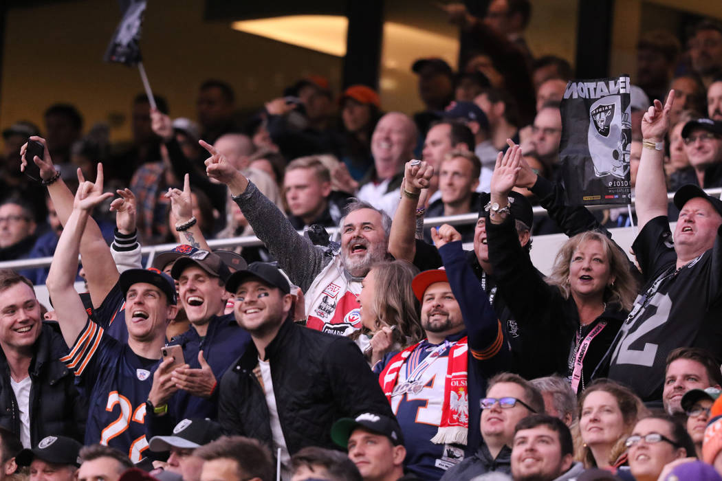 Fans cheer during an NFL game between the Oakland Raiders and the Chicago Bears at Tottenham Ho ...