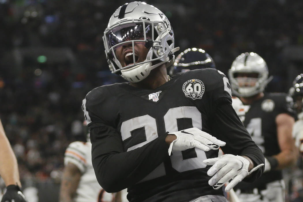 Oakland Raiders running back Josh Jacobs (28) celebrates after scoring a touchdown during the f ...