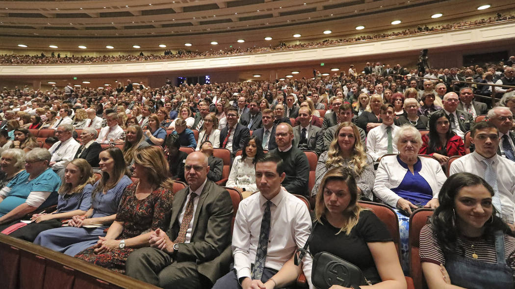 People listen during The Church of Jesus Christ of Latter-day Saints' twice-annual church confe ...