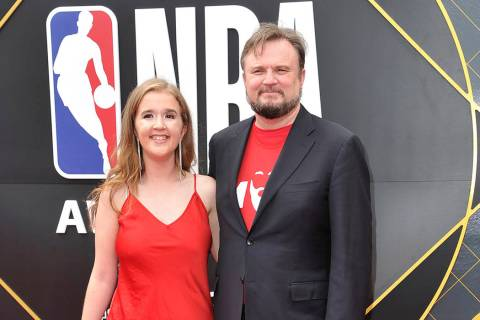 Daryl Morey, general manager of the Houston Rockets, right, and Ellen Morey arrive at the NBA A ...