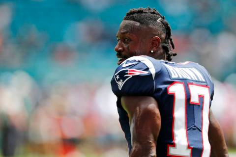 New England Patriots wide receiver Antonio Brown (17) stands on the sidelines during the first ...