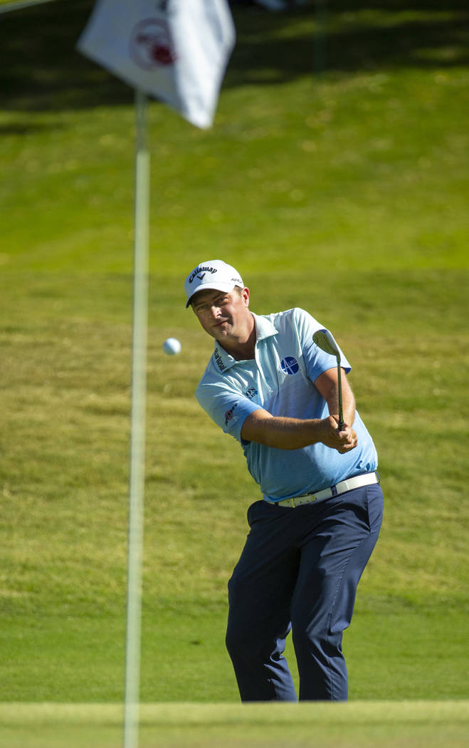 Brain Stuard chips onto the green at hole 9 during the final round of Shriners Hospitals for Ch ...