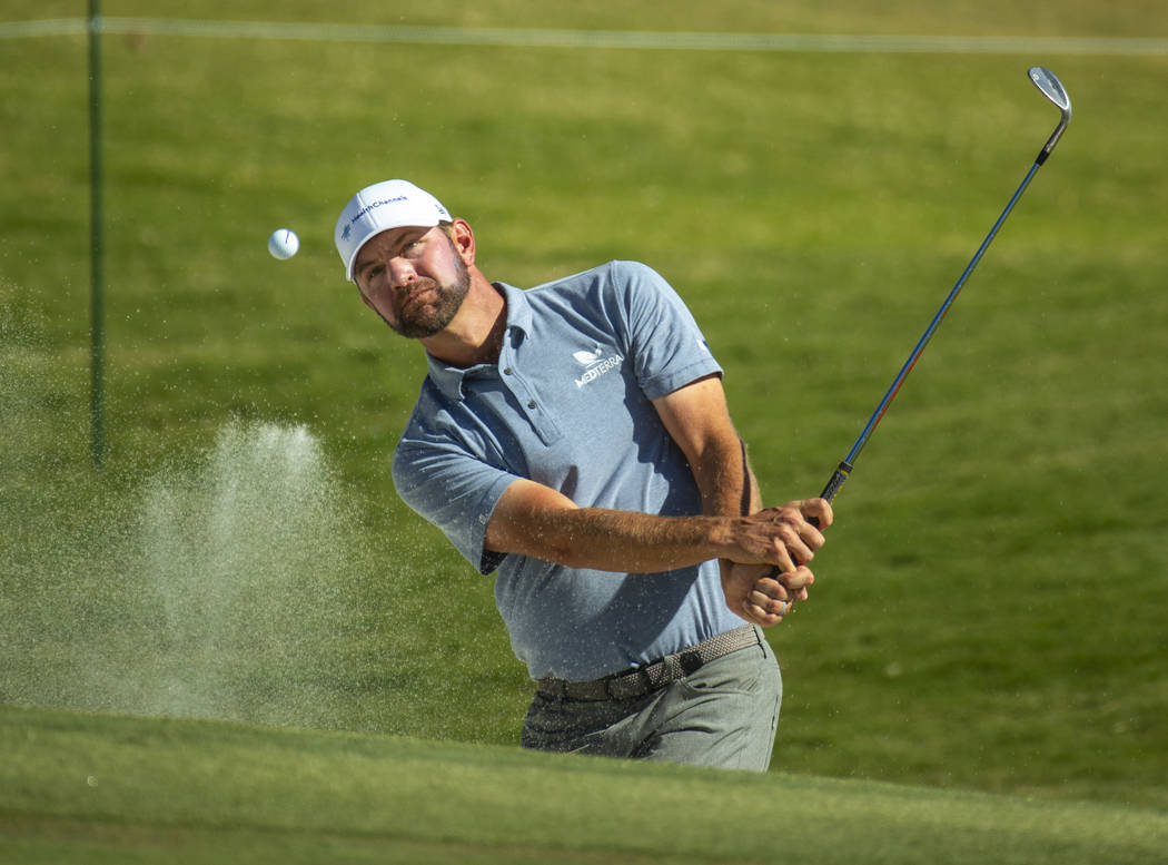 Lucas Glover hits out of the bunker onto the green at hole 9 during the final round of Shriners ...